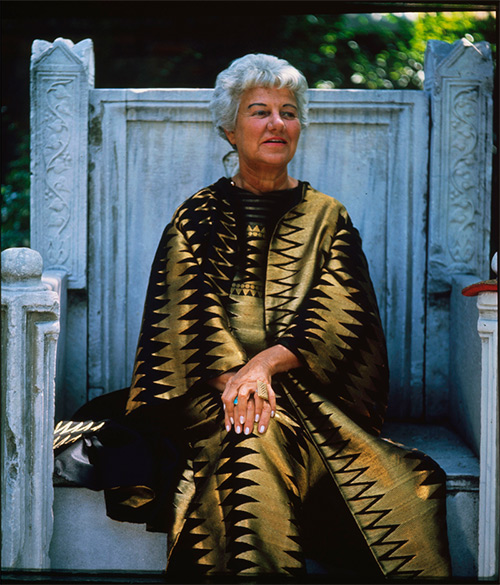 Peggy Guggenheim sitting on the throne in the garden of Palazzo Venier dei Leoni, Venice, 1960s