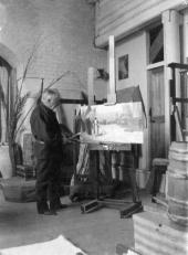 Polenov in his studio on Borok estate. 1908