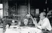 "ALEXANDER ARCHIPENKO IN HIS STUDIO, WORKING ON THE PLEXIGLAS SCULPTURE ""ONWARD"","