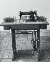 SEWING MACHINE OF TIME SURROUNDED WITH NAILS. 1963