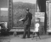 Isaac Levitan at work in his Moscow studio. 1890s. Photo